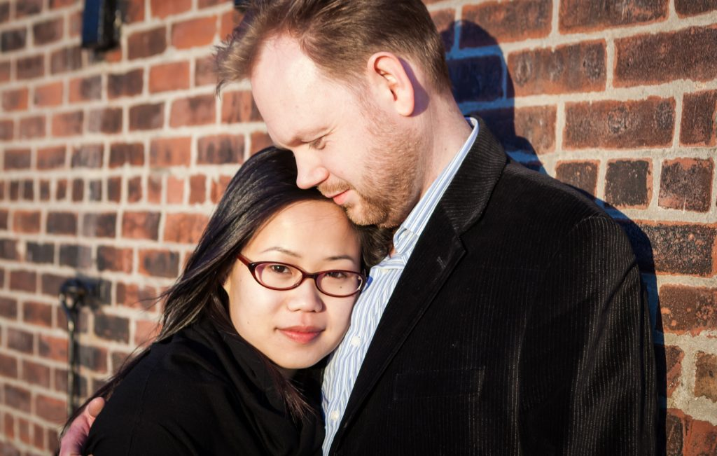Red Hook engagement photos of couple against brick wall