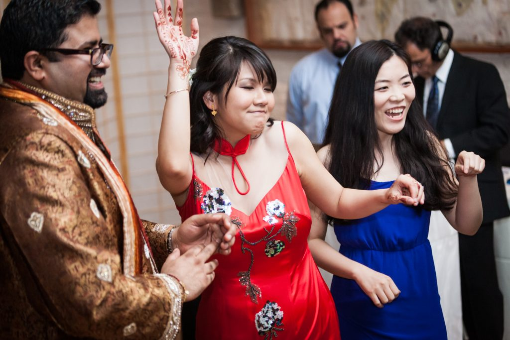 Bride in red qipao dancing at an Alger House wedding