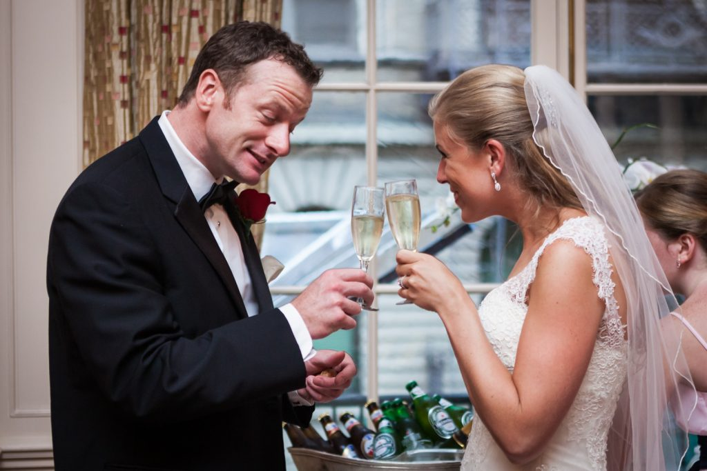 Bride and groom toasting champagne glasses at a Harvard Club NYC wedding