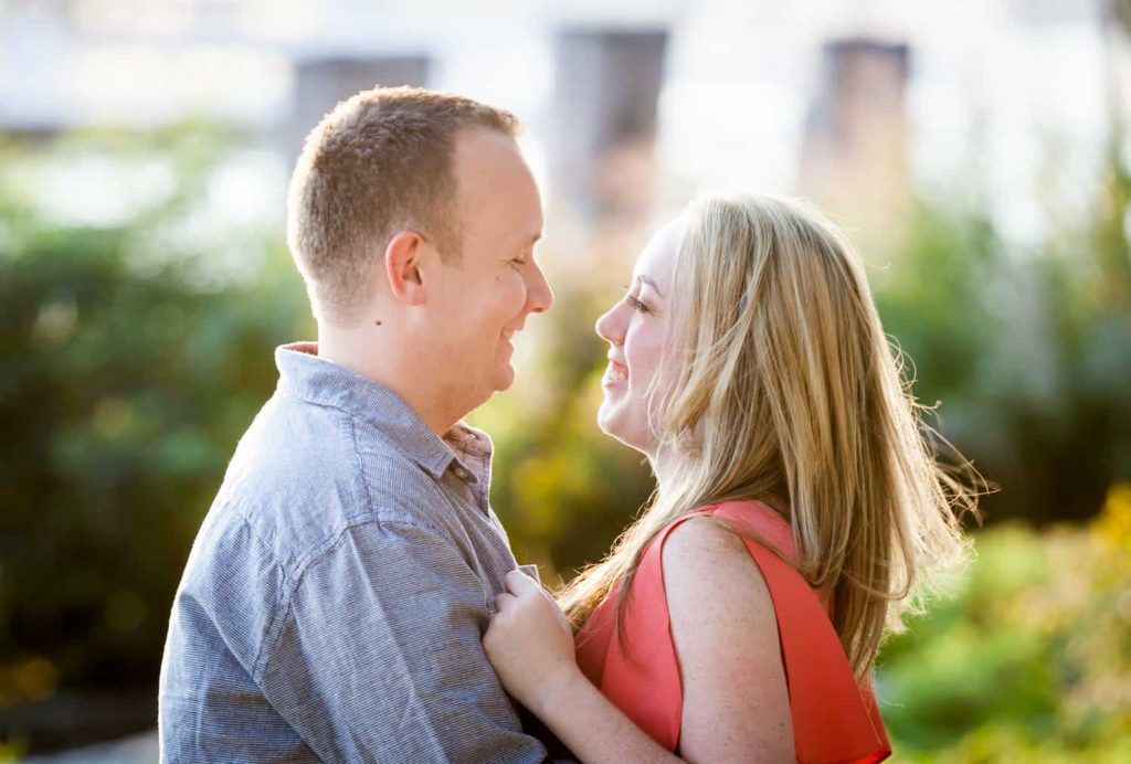 Couple looking at each other at a Battery Park engagement shoot