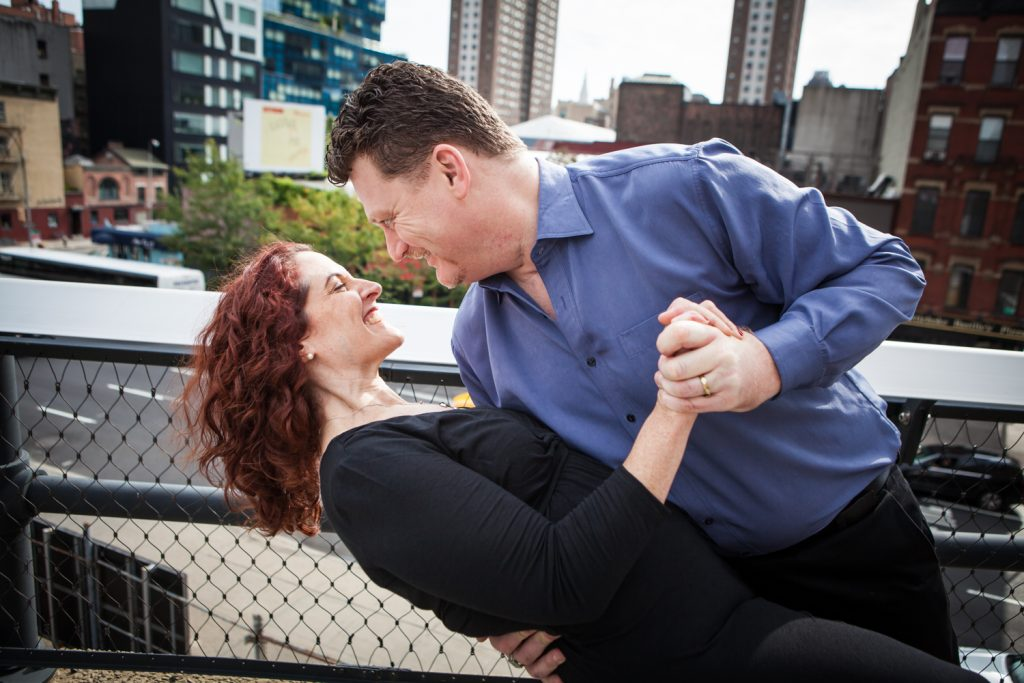 High Line engagement photos of couple dancing on observation deck