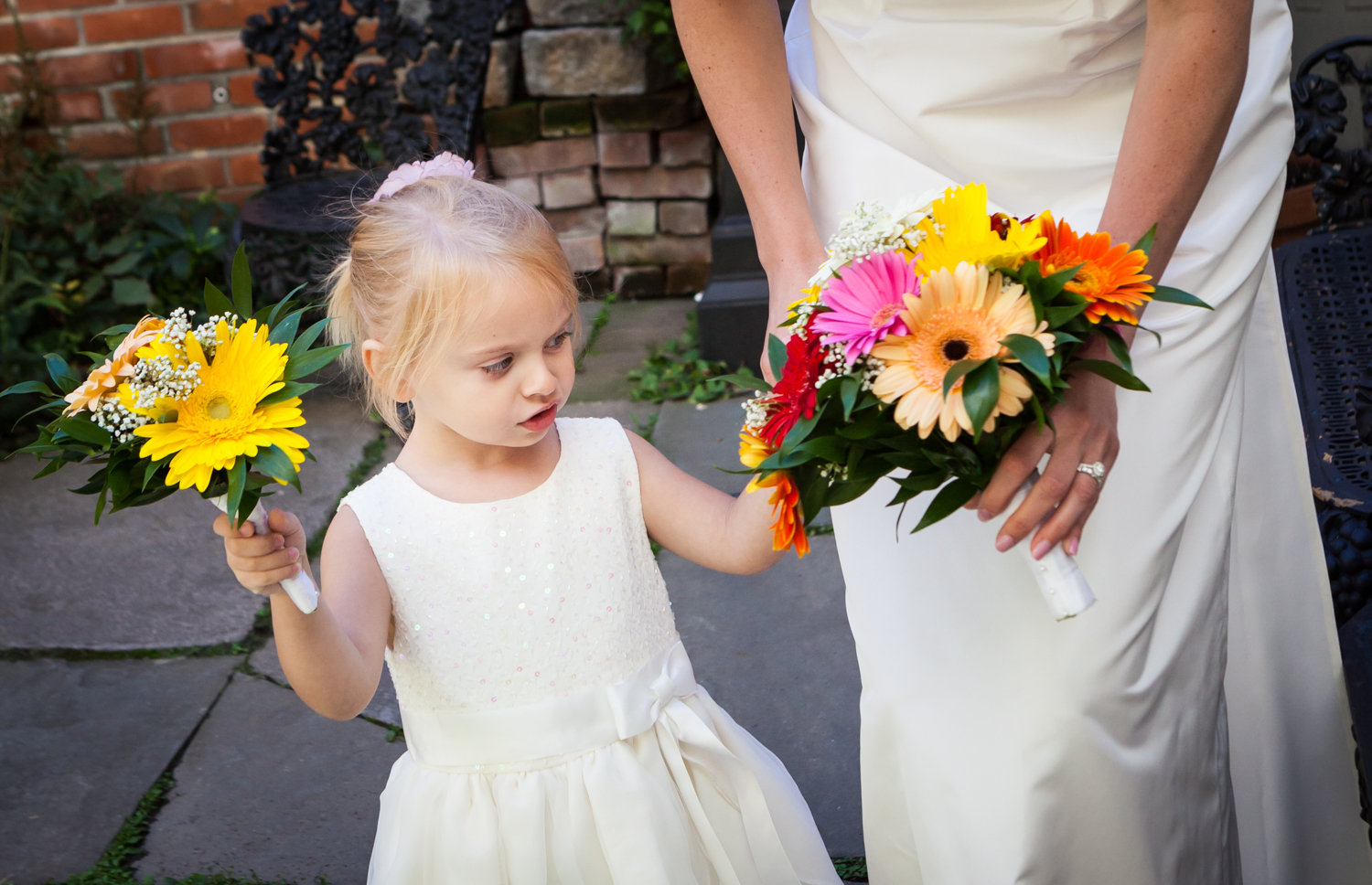 Merchant's House Museum wedding photos of little girl looking at bride's bouquet