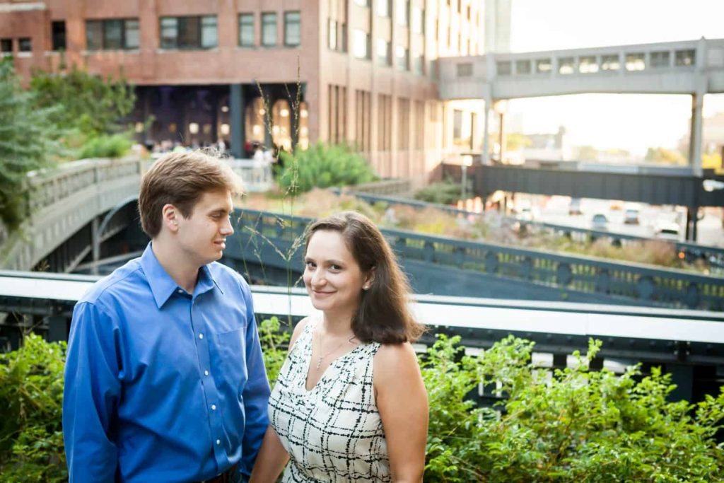 Couple with view of High Line in background during High Line engagement session
