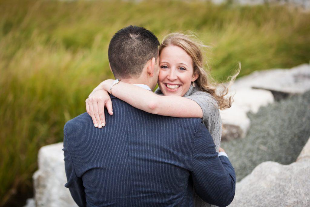 Couple hugging during a Brooklyn Bridge Park engagement shoot