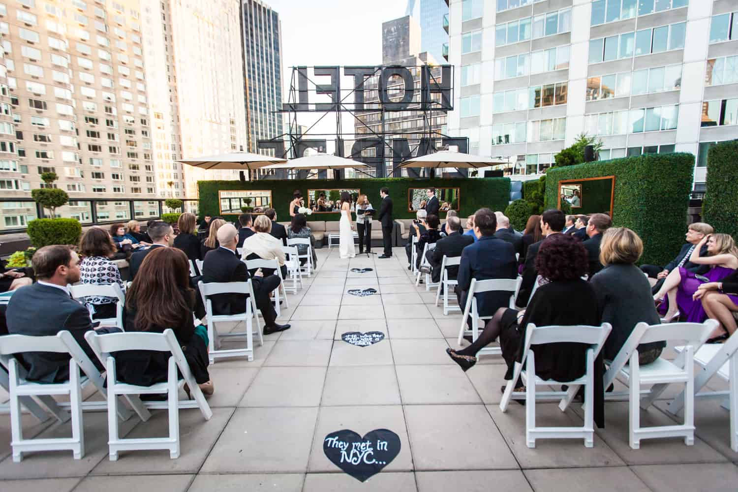 Wide shot of ceremony at an Empire Hotel rooftop wedding