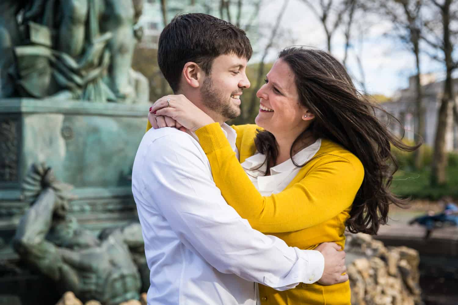 Grand Army Plaza engagement photos of couple hugging