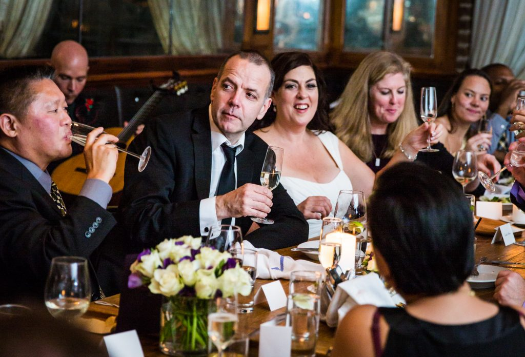 Bride and groom surrounded by guests at a Locanda Verde wedding reception