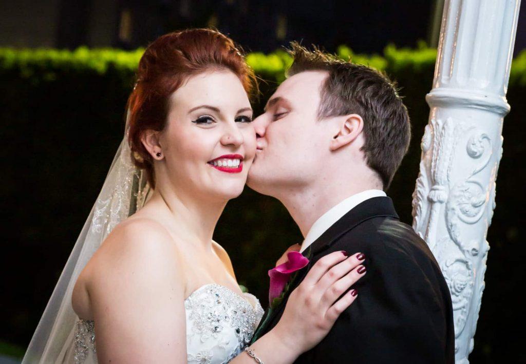 Nicotra's Ballroom wedding photos of groom kissing bride on the cheek