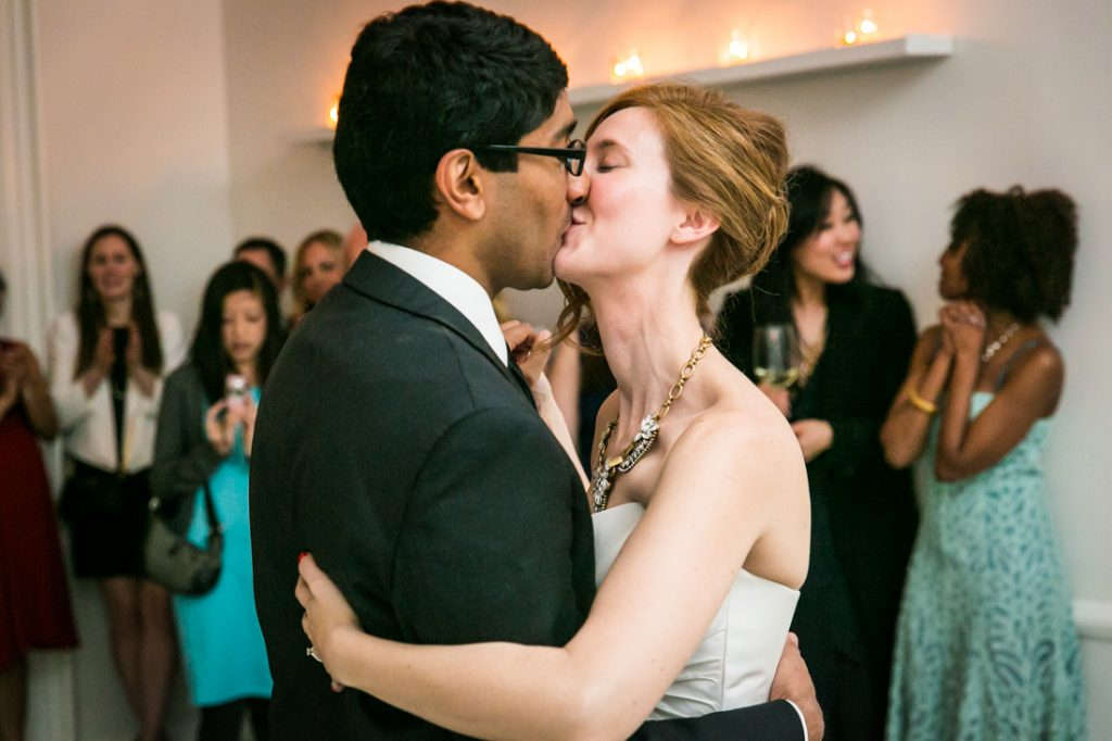 Bride and groom kissing during first dance at a Maison May Brownstone wedding
