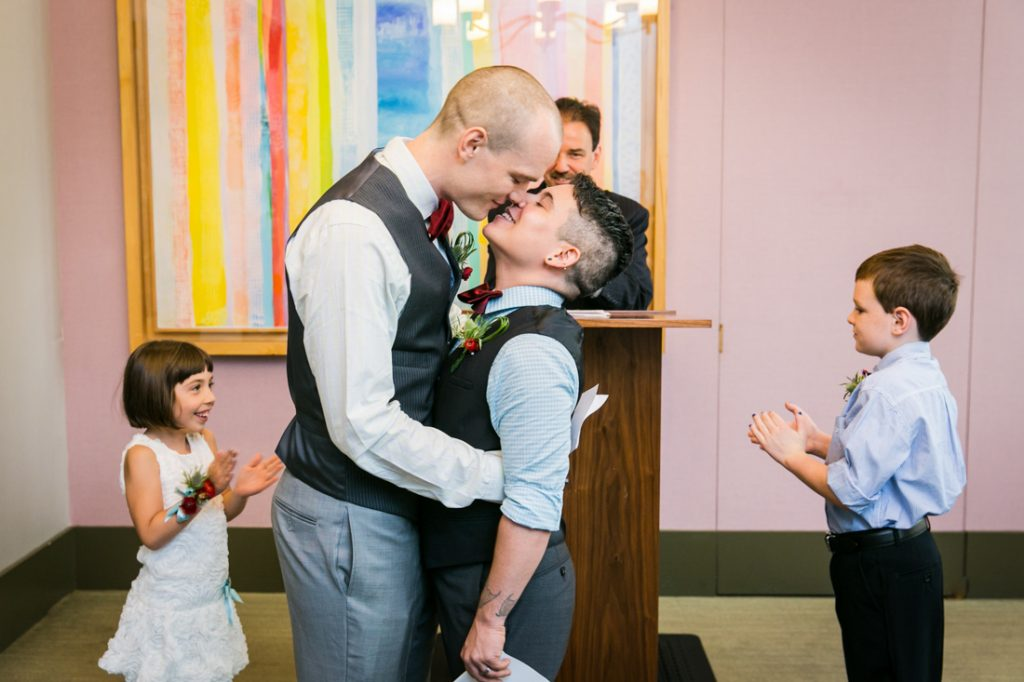 Two grooms kissing after a NYC LGBTQ City Hall wedding ceremony