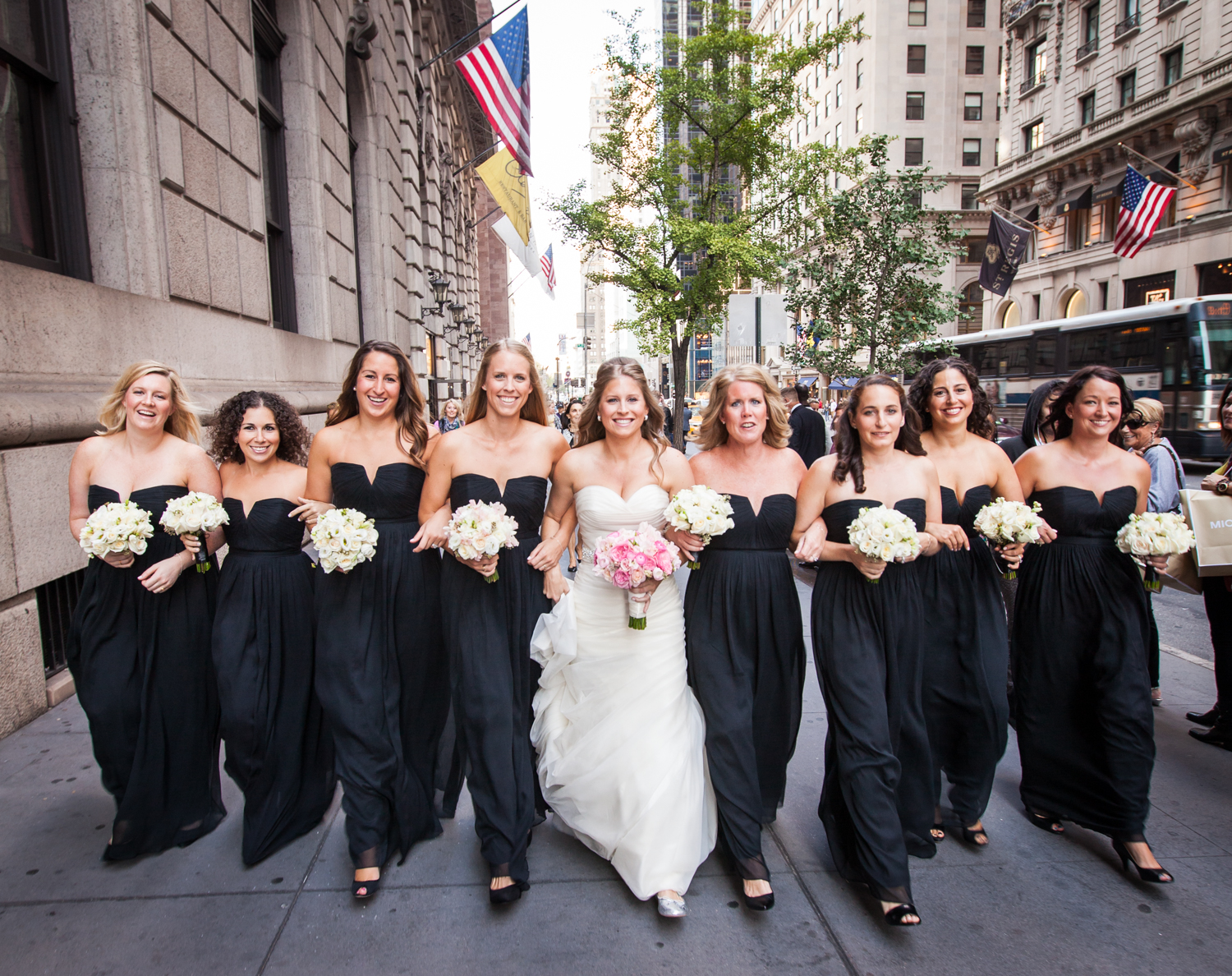 Bride and bridesmaids marching down Fifth Avenue before a University Club wedding