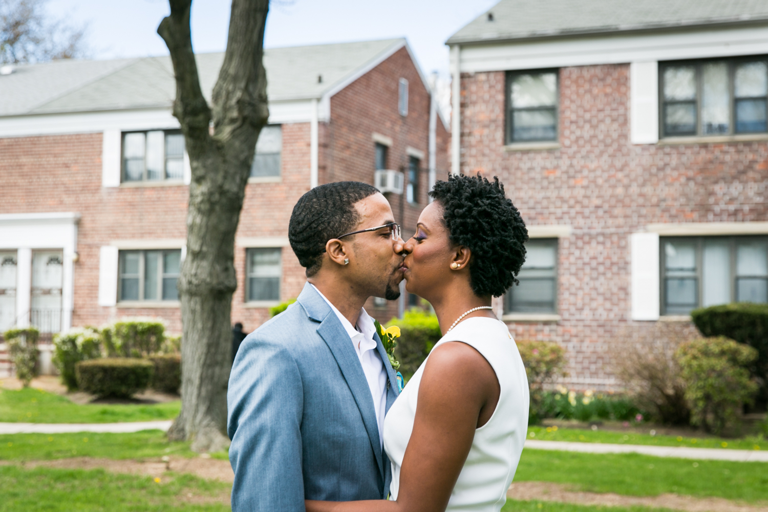 Bride and groom kissing after first look at a Flushing Meadows Corona Park wedding