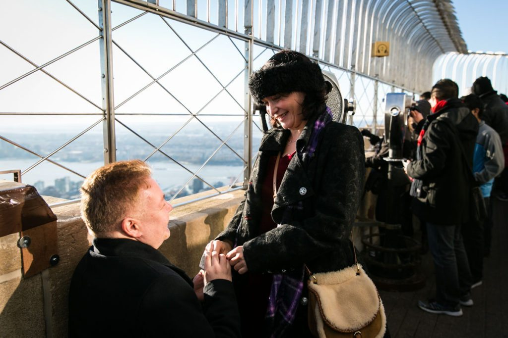 Man proposing for an article on an Empire State Building proposal