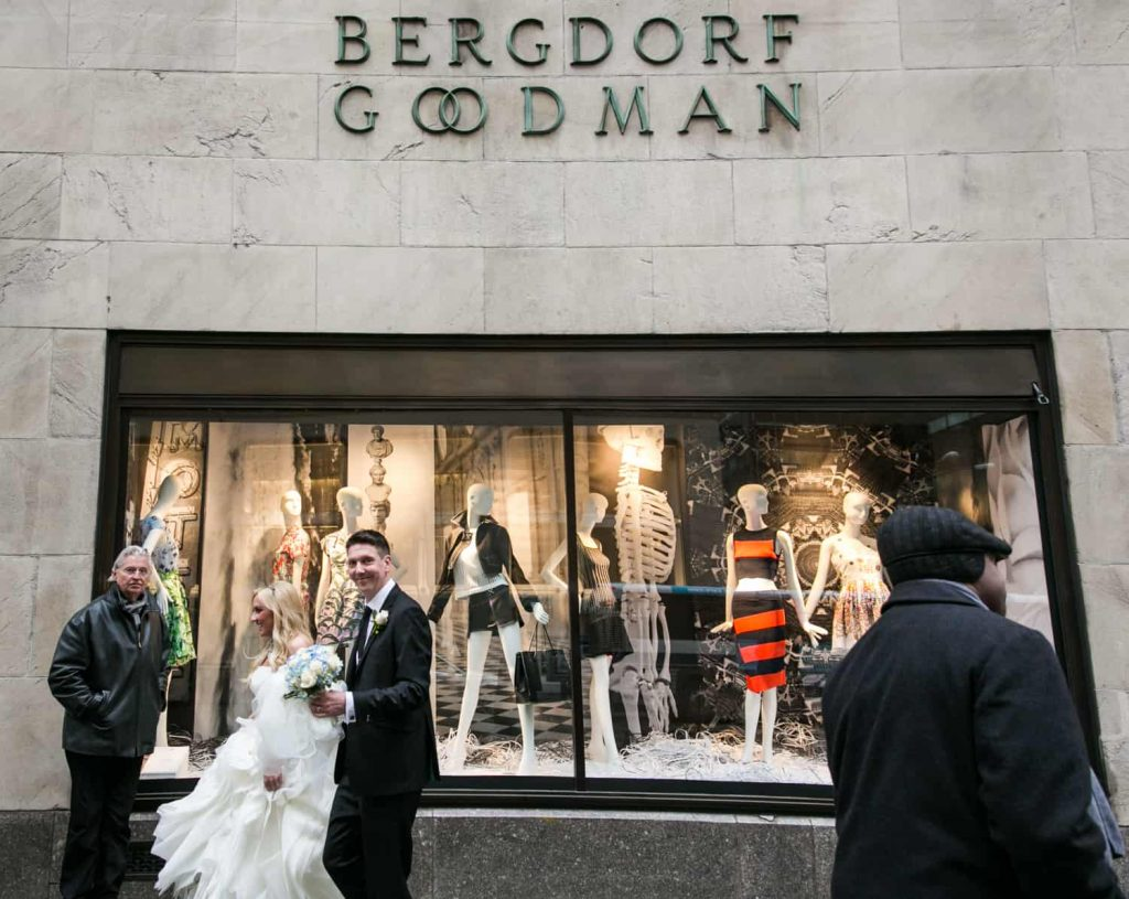Bride and groom walking past Bergdorf Goodman