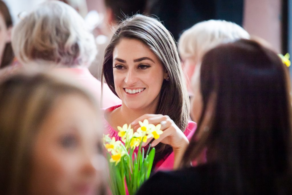 Bride smiling over daffodils at a NYC bridal shower