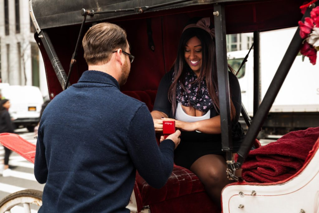 Brandon asks his girlfriend to marry him during a Central Park carriage ride, by NYC wedding photojournalist, Kelly Williams