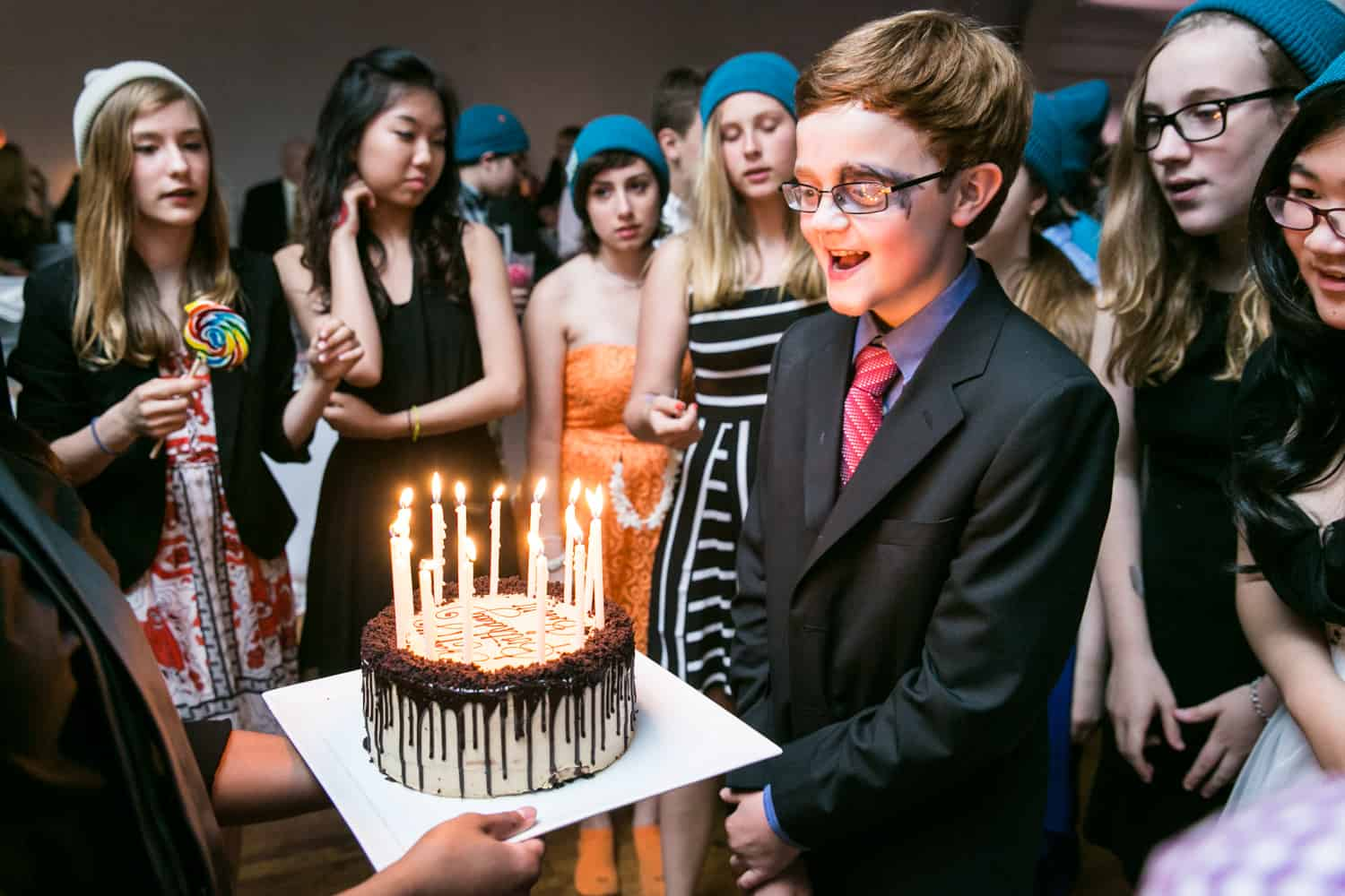 Boy blowing out birthday candles for an article on how to plan the perfect bar mitzvah
