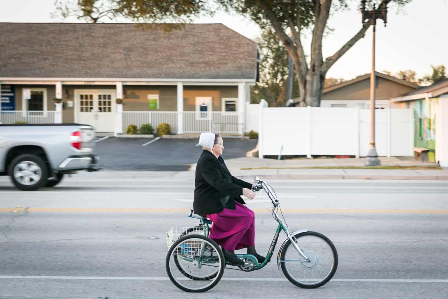 Photos of Sarasota including woman wearing bonnet on bicycle in Pinecraft