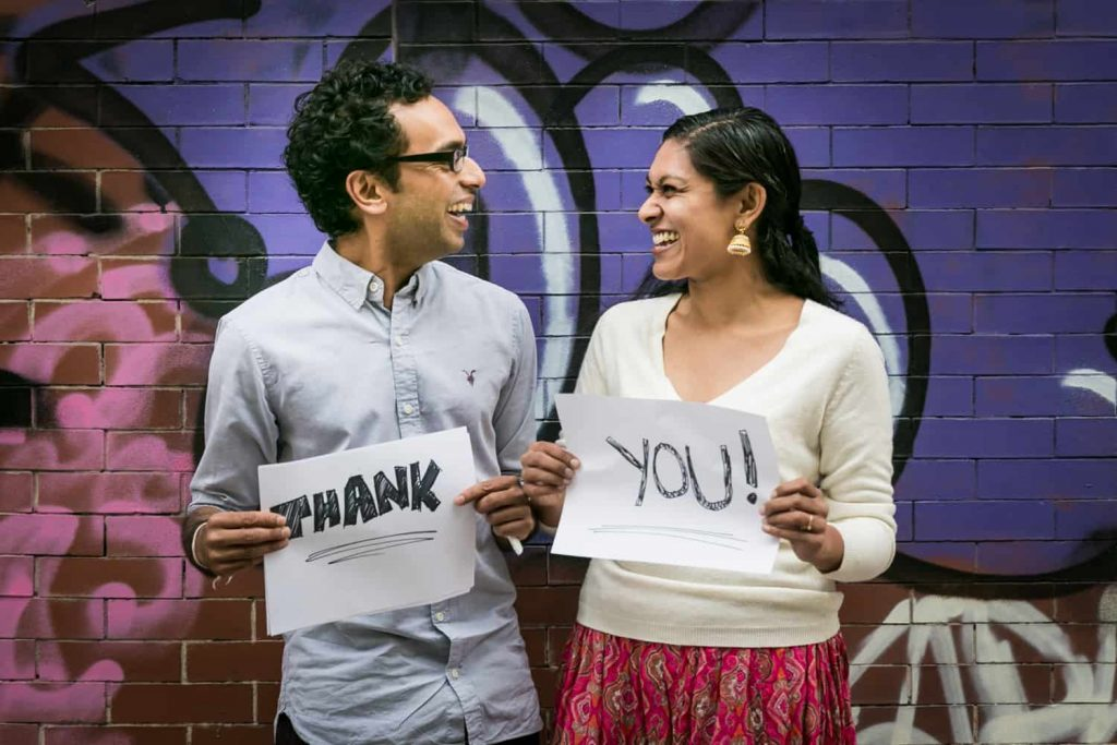 Thank you card photos of couple laughing and holding signs