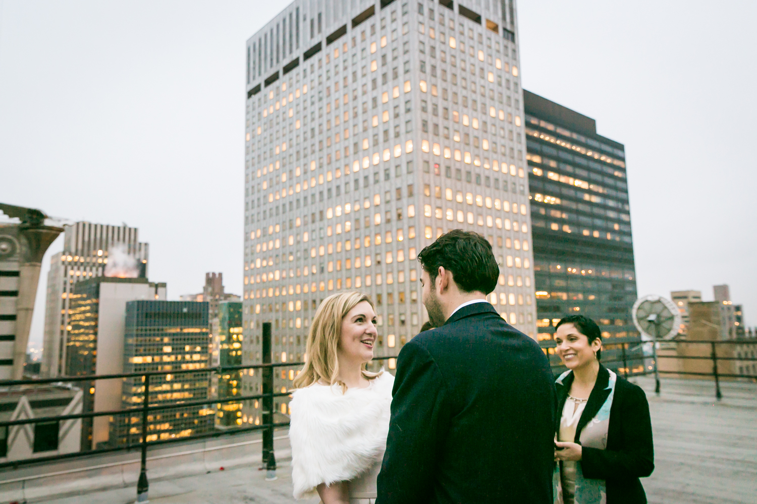Bride and groom exchanging vows at a Grand Hyatt Hotel rooftop wedding