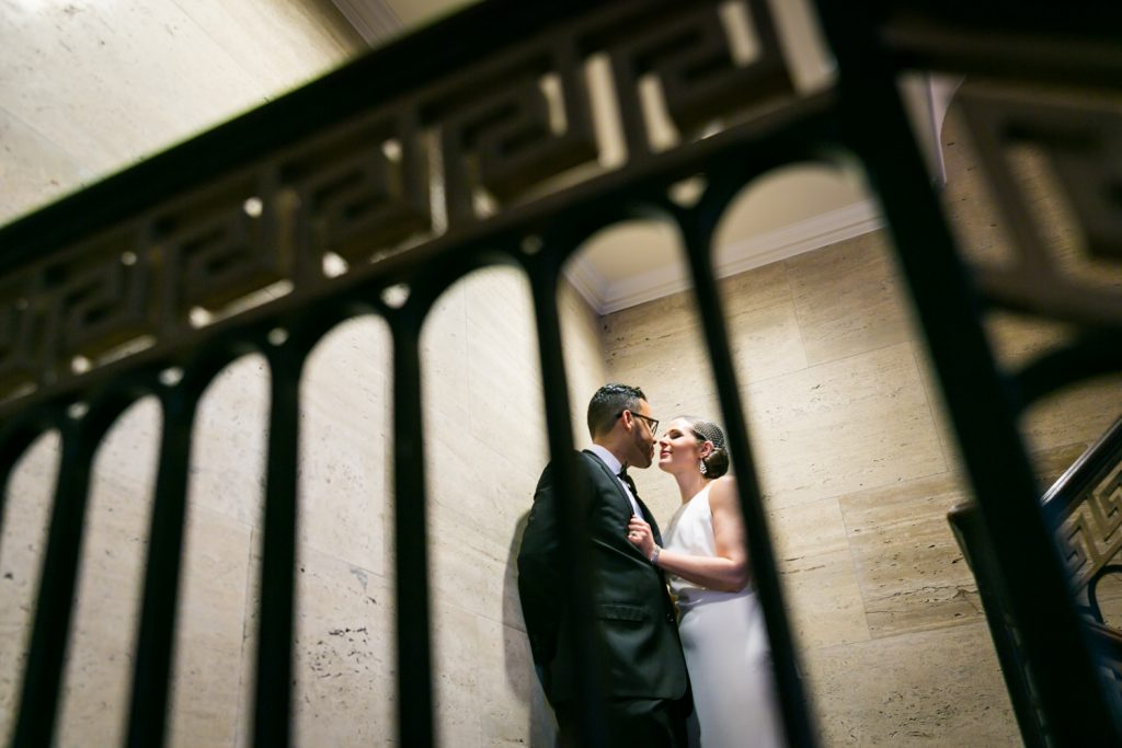 Bride and groom about to kiss in stairwell in Roosevelt Hotel wedding photo