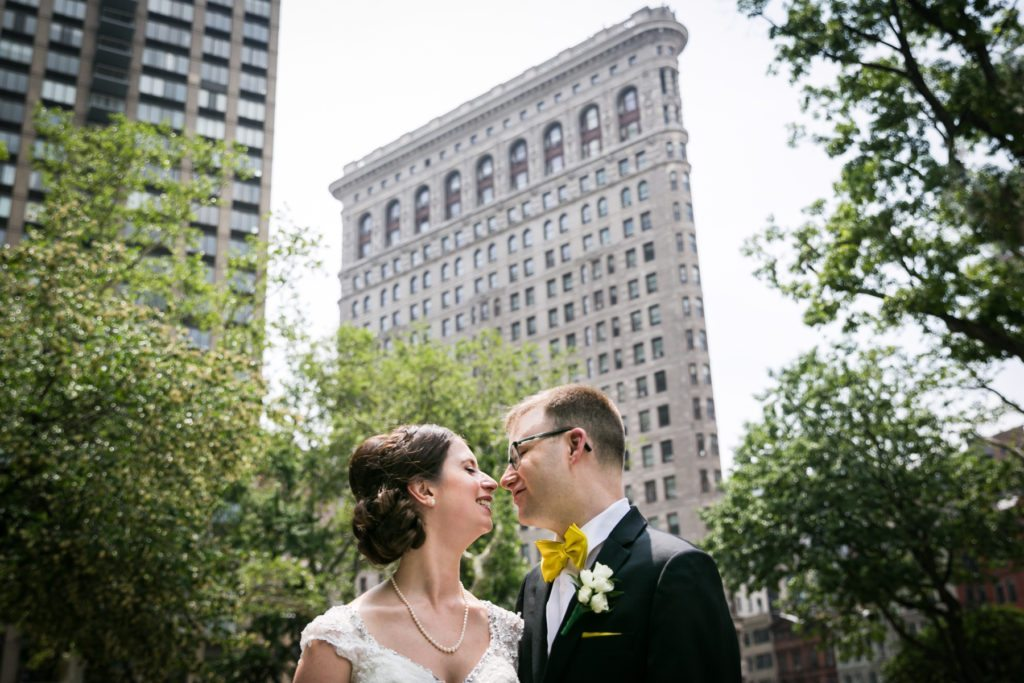 Bride and groom portrait in Madison Square Park for a Columbus Citizens Foundation wedding by NYC wedding photojournalist, Kelly Williams