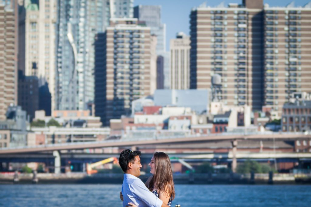 Couple in front of NYC skyline for article on how to plan a surprise wedding proposal