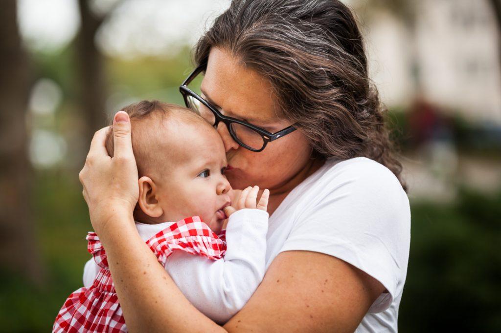 Mother kissing little girl's head