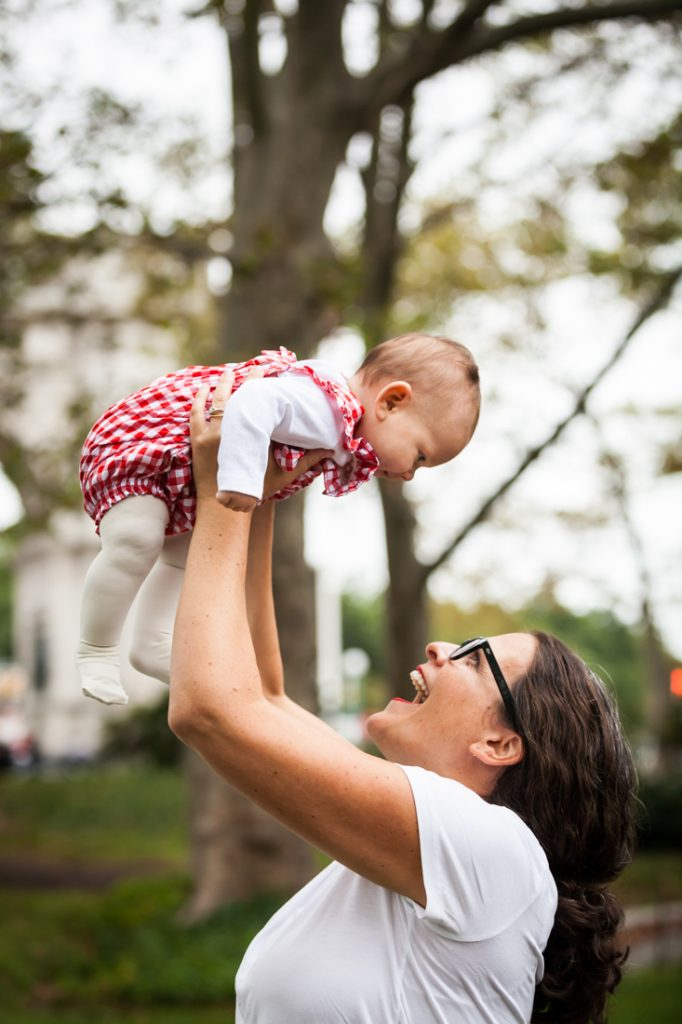 Mother holding little girl in the air