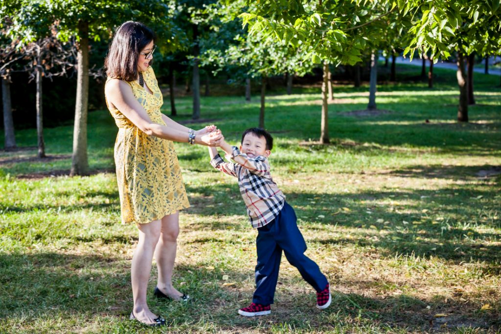 Mother playing with son in Elmhurst Park by Kew Gardens family photographer, Kelly Williams