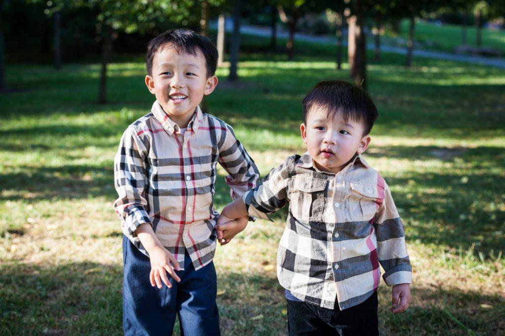 Two little boys in Elmhurst Park by Kew Gardens family photographer, Kelly Williams