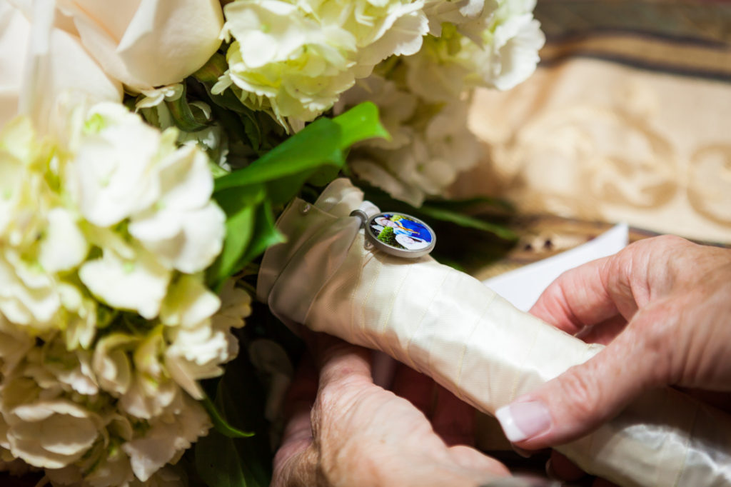Photo locket on bouquet for an article on creative borrowed and blue wedding ideas