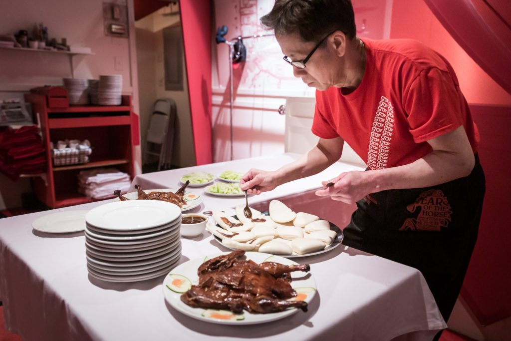Waiter serving Peking duck at Dim Sum Go Go