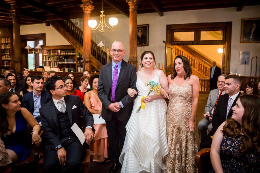 Bride coming down the aisle at a Brooklyn Historical Society wedding