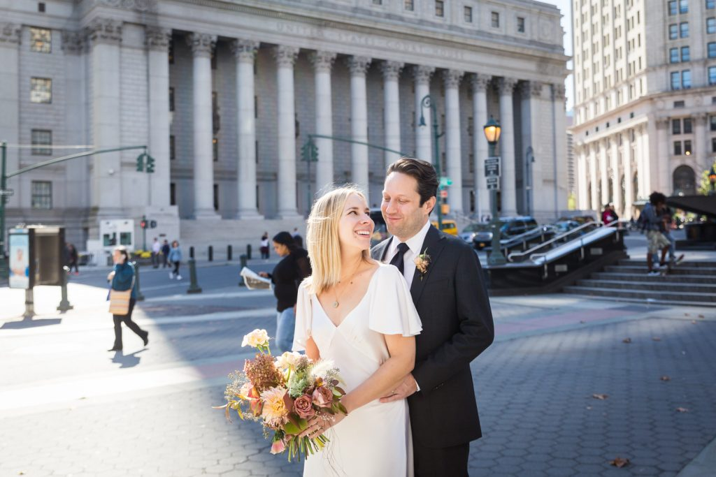 Bride and groom portrait in front of courthouse