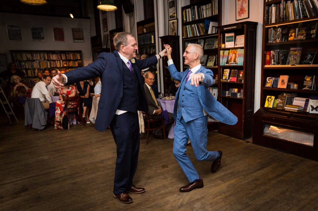 Two grooms dancing at a Housing Works Bookstore Cafe wedding