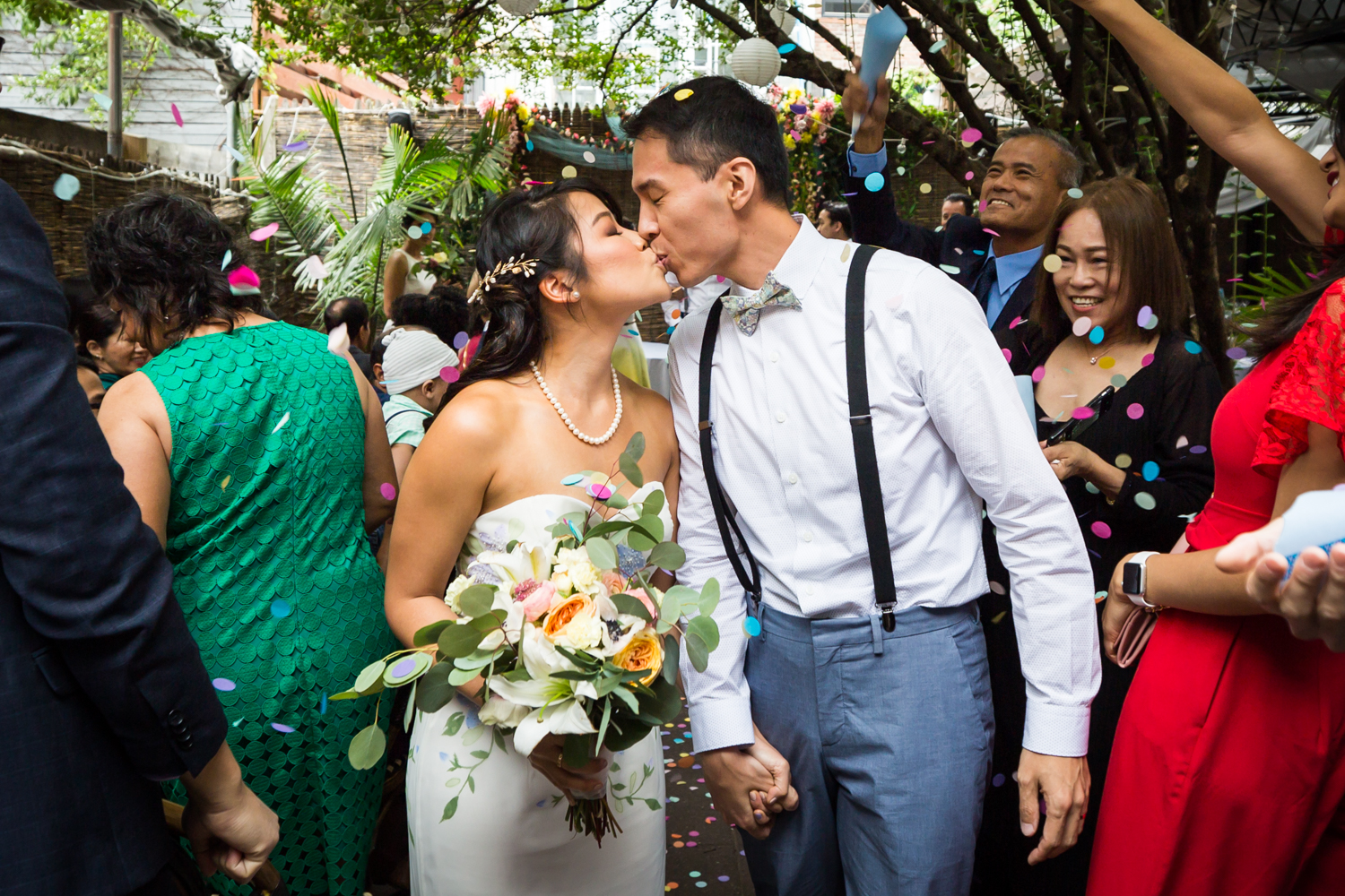 Bride and groom kissing after ceremony for an article on the pros and cons of a restaurant wedding