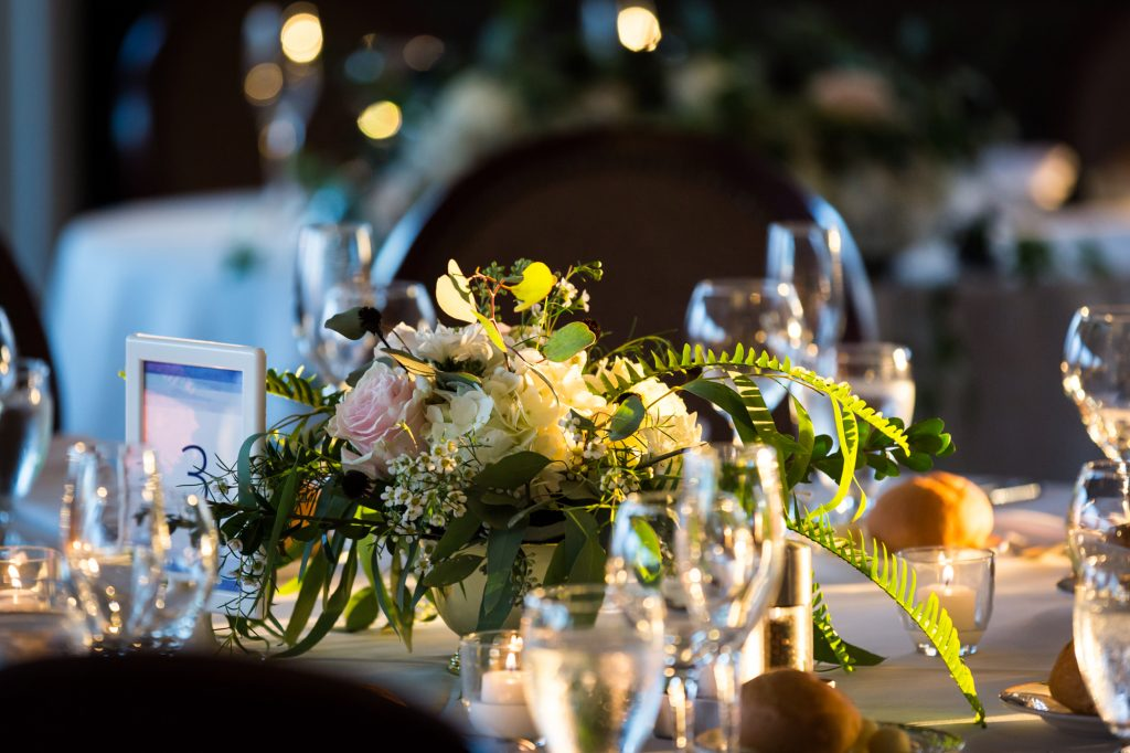 Floral centerpieces at a Larchmont Shore Club wedding