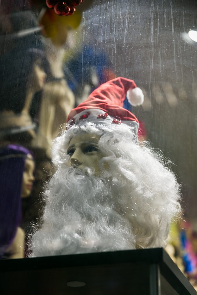 Mannequin with santa hat for an article on NYC holiday card location suggestions