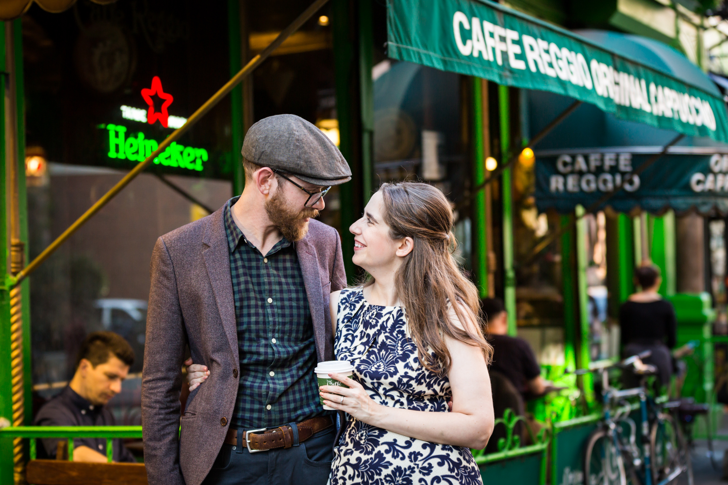 Couple in front of Caffe Reggio on MacDougal Street for a Greenwich Village engagement portrait