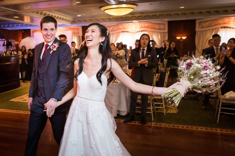 Bride and groom entering reception at a Westbury Manor wedding