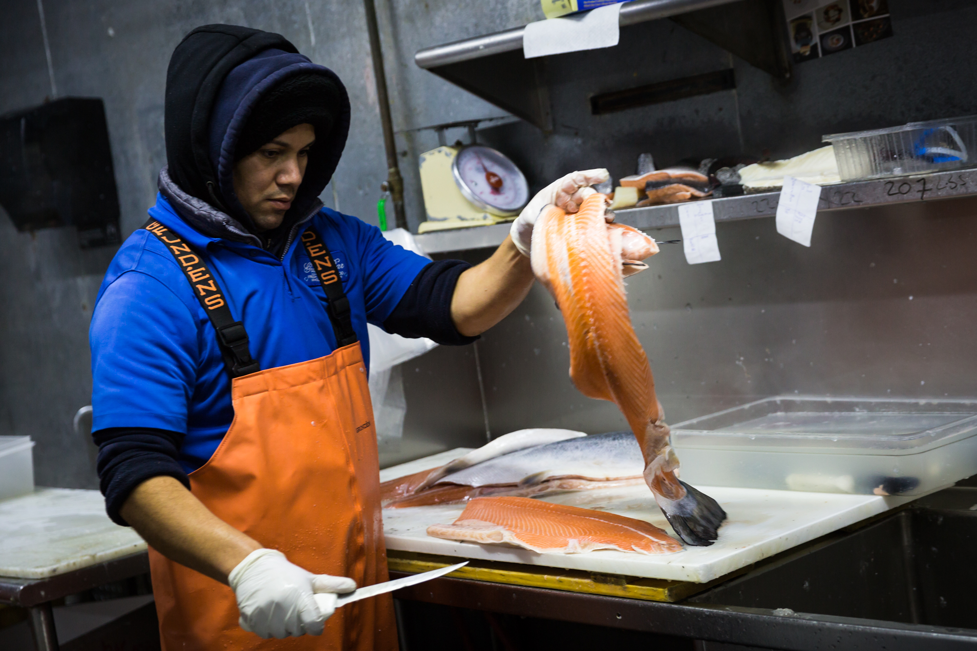 Salmon being cut for an article on website photography tips