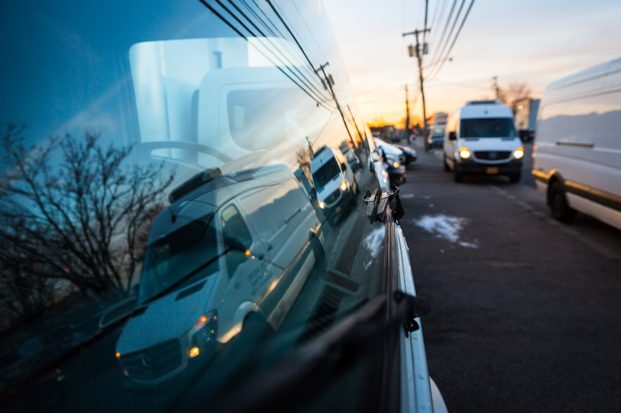 Trucks in a window reflection for an article on website photography tips