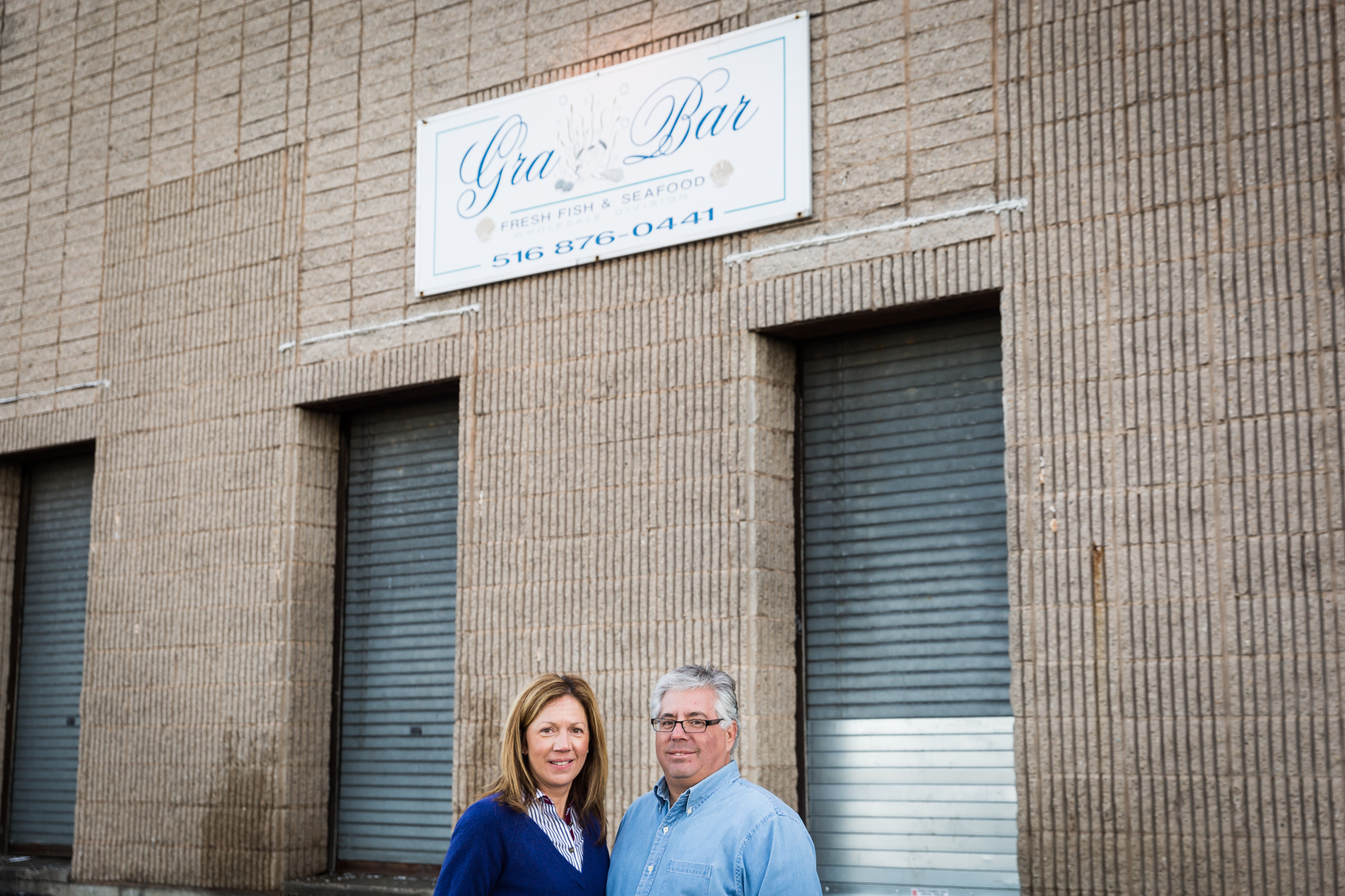 Owners of Gra Bar Fish for an article on website photography tips