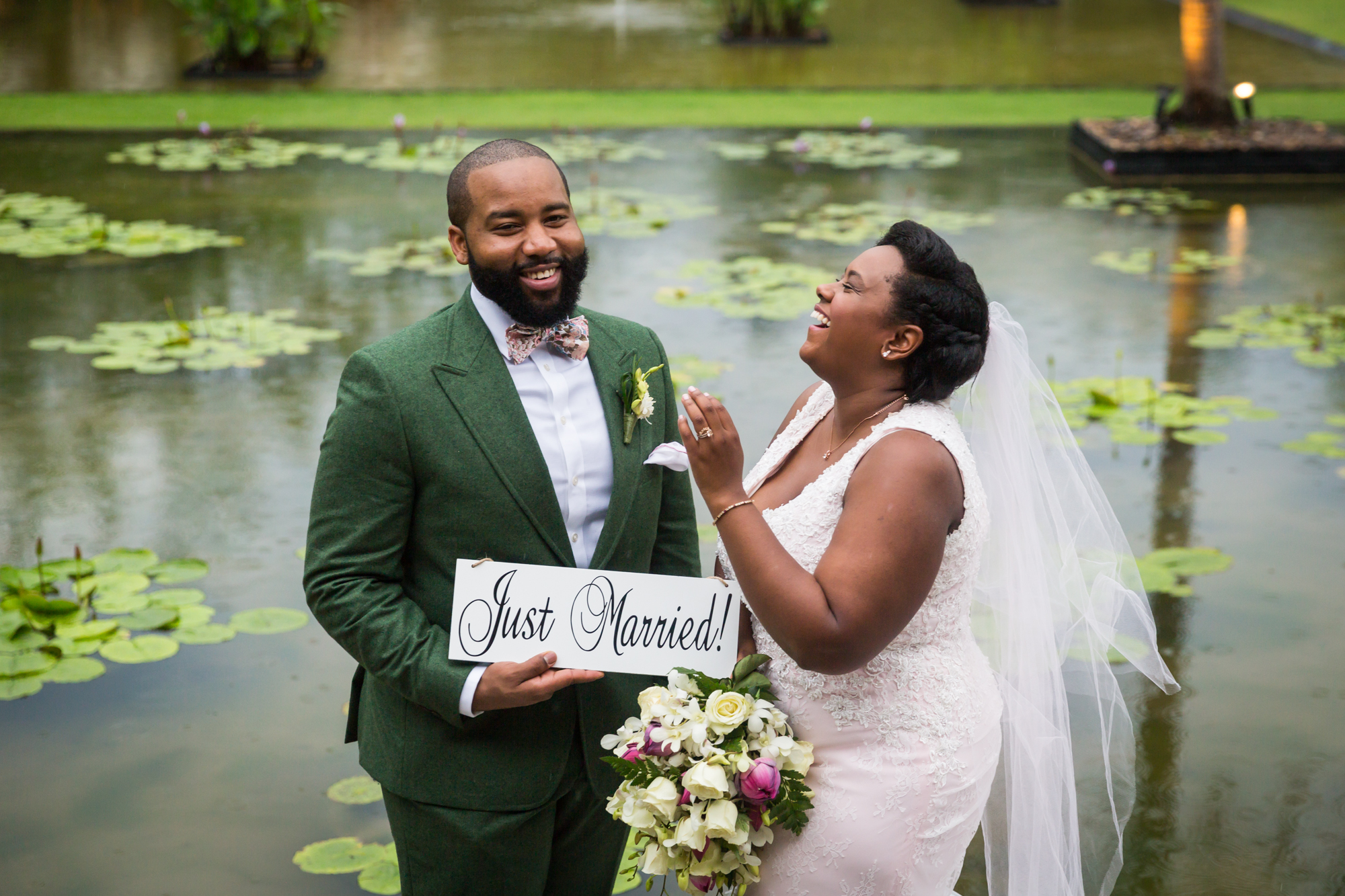 Bride and groom with 'Just Married' sign for an article on destination wedding photography tips
