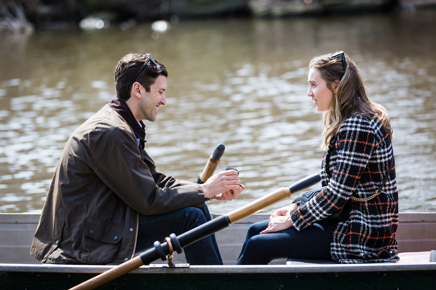 Man in boat asking his girlfriend to marry him for an article on Central Park Lake proposal tips