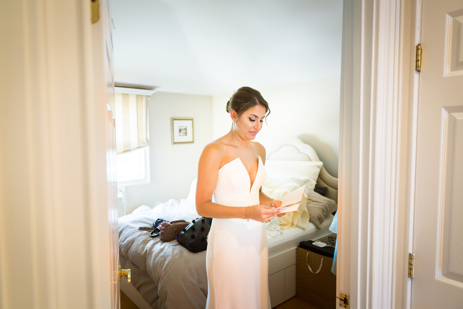 Bride reading groom's letter for an article on Bronx Zoo wedding venue updates