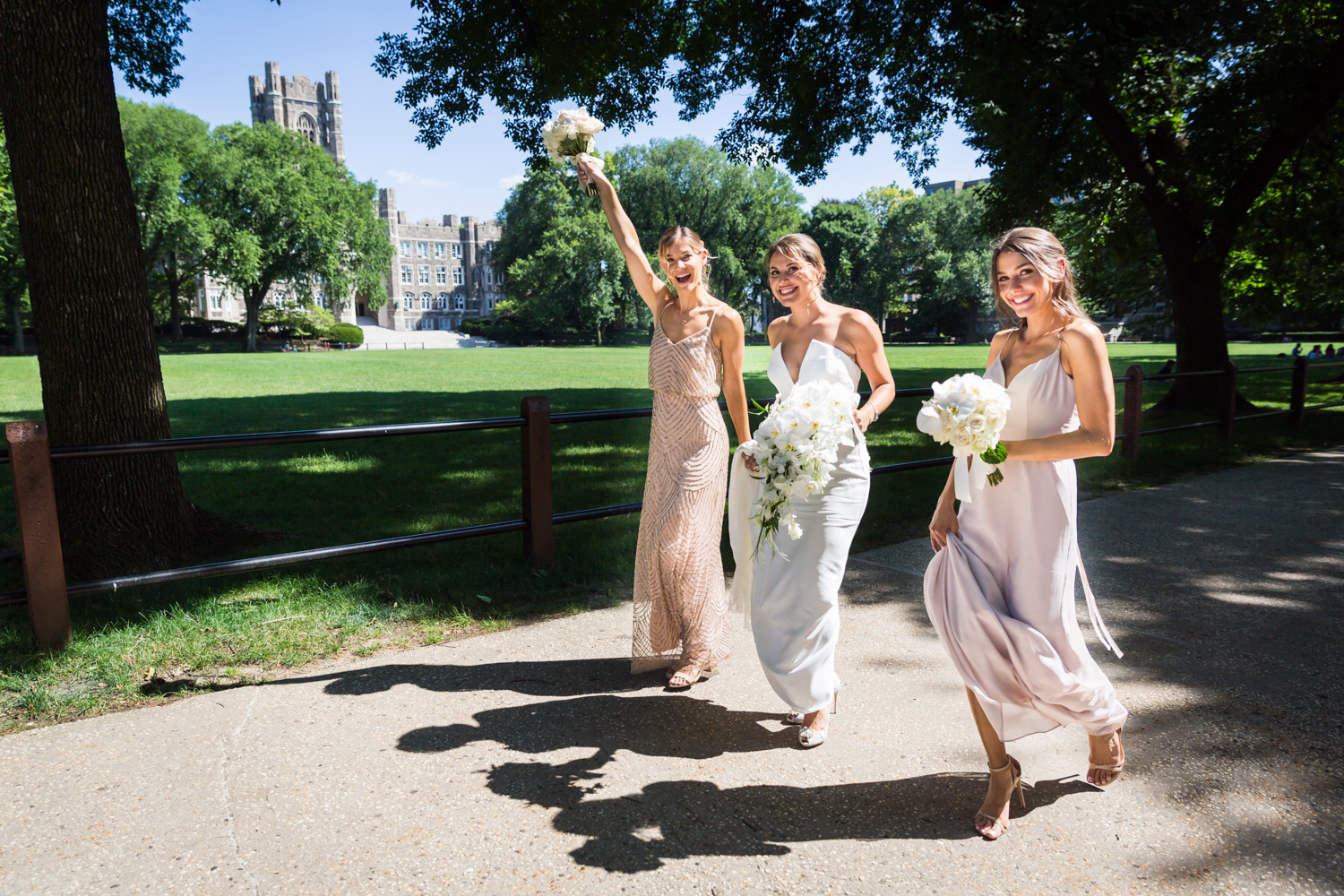 Bride and bridesmaids cheering for an article on Bronx Zoo wedding venue updates
