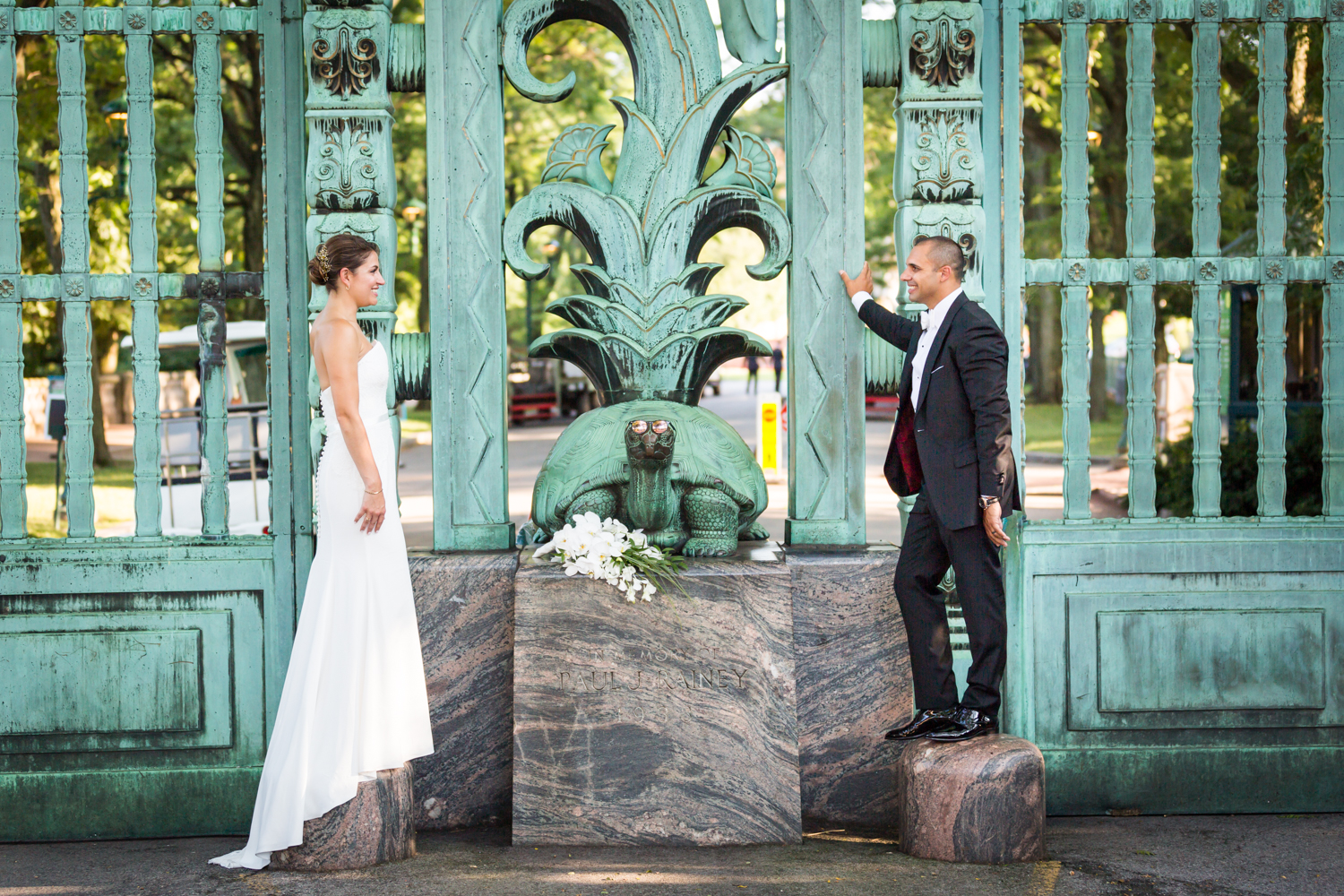 Bride and groom outside Southern Boulevard gates for an article on Bronx Zoo wedding venue updates