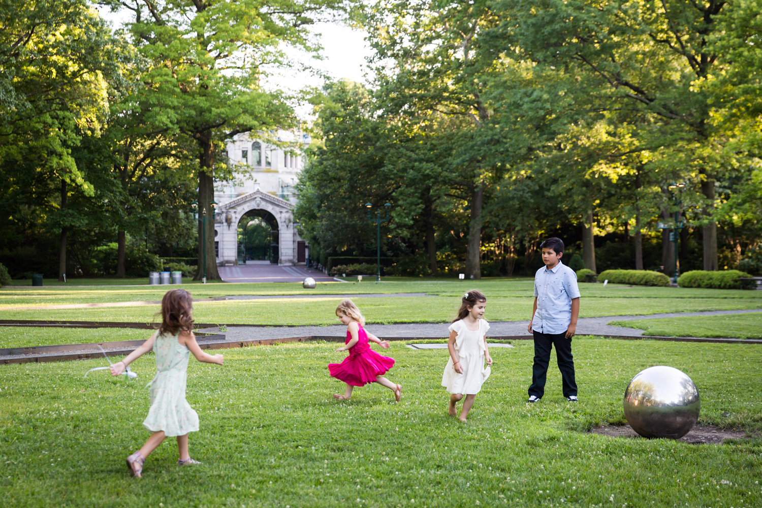 Children playing on Astor Court for an article on Bronx Zoo wedding venue updates